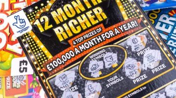 12 months richer pile of scratchcards